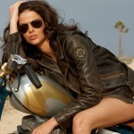 Biker-Girl-Motorcycle-Gril-of-the-Week-Wearing-Brown-Leather-Jacket-Aviator-Sunglasses-and-Denim-Shorts